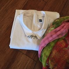 GAP white shirt GAP white shirt. Cute white collar....zips up back..sleeveless-- great for layering. GAP Tops Blouses