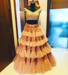 ~Bloom~Here's Architha Narayanam  signature! This Elegant and grand tulle lehenga where a 100 meters went in to it to get this royal look perfect for your wedding soirées! 31 July 2018