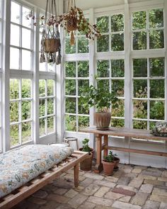 Decorate your orangery with a daybed and add floral fabrics and potted plans to create a cozy zone. Old windows and hanging plants from ceiling. Outdoor Rooms, Outdoor Living, Outdoor Decor, House Windows, Glass House, Cabana, My Dream Home, New Homes, Home And Garden