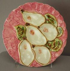 Stangl Pottery; Majolica, Oyster Plate, 5 Wells, Turkey, Pink, 9 inch. (love majolica) In Charleston everyone wants oyster plates in their dinning rooms or foyers hanging on the wall.