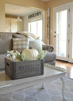 Wooden crate with white pumpkins and a bit of greenery make a great simple Fall centerpiece