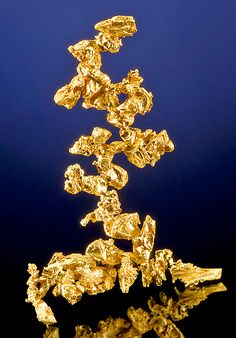 crystals of Native Gold, From the Ganzhizhou Mine, Meigu County, Sichuan Province, China. Measures 6 cm by 3.9 cm by 2.2 cm in total size.