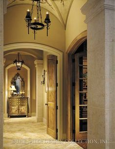 A Gallery leading to the Master Foyer, featuring a groin vaulted ceiling from Sater Design's Luxury Plan Collection...