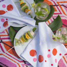 Paint the edge of your white napkins to go with any party theme including this tropical tribal luau party.
