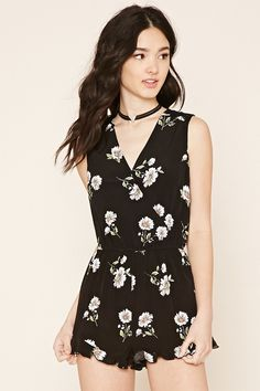 A sleeveless woven romper with a self-tie V-cutout back, a surplice front, an allover floral print, floral lace panels on the shoulders, an elasticized waist, on-seam side pockets, and a ruffled hem.