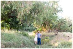 Country Engagement Portrait | couple standing in the middle of a field