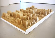 Synoptic Office created a topographic map of the English alphabet based on how frequently each letterform was used in words. They modeled each letter in Rhino and exported sections to AutoCad. Laser cut in sections on architectural butter board, each letter sits in a 6×6 inch square, allowing for any combination of letters to run seamlessly both horizontally and vertically.