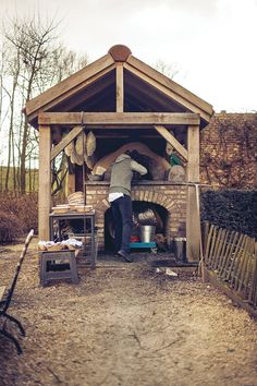 Outdoor wood oven and cover.