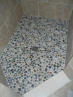This is literally river rocks from the dollar store on this woman's shower floor. Looks amazing!