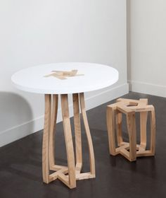 a table and stool whose entire structure relies on five identical elements - which are up-side-down & shapes - fitting into one another. Table Furniture, Furniture Making, Furniture Design, Retro Furniture, Classic Furniture, Modern Table Legs, Geometric Side Table, Concrete Wood, Small Tables