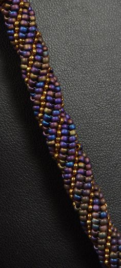 Beadwoven Necklace Tutorial Triple Twist Necklace by NEDbeads Techniques: twisted herringbone stitch, Russian spiral stitch and a bugle bead rope, as well as right angle weave and peyote stitches. Beads Jewelry, Jewelry Show, Jewelry Crafts, Handmade Jewelry, Jewelry Design, Jewelry Making, Beaded Bracelets, Jewellery, Necklace Tutorial