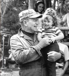 Doting dad: Holding his daughter Marisa, while on the set of the film, Hellfighters in 1968, the little girl, three years old at the time, adored her daddy. He was a towering presence in his children's lives and always told them he was a 'proud and happy father'. He spent more time with the children he had with Pilar because he was in his sixties and working less on film locations. 'I'm a demonstrative man, a baby picker-upper, a hugger and a kisser—that's my nature'. 'He was just a regular…