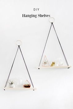 DIY Hanging Shelves -- a decor tutorial from Why Don't You Make Me. Such a cute idea for vertical space on your walls!