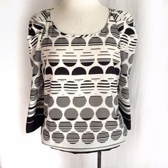 "The Limited Black/White Top✨Host Pick✨ Black and white graphic patterned blouse from The Limited. The puckered sleeves add a hint of drama. Smocked hem can be worn loose or covered with a great belt. Three quarter sleeves. Size small. 100% polyester. Bust: 19"" across. Length: 26"" The Limited Tops"