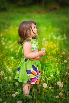 Cute girl and dandelions