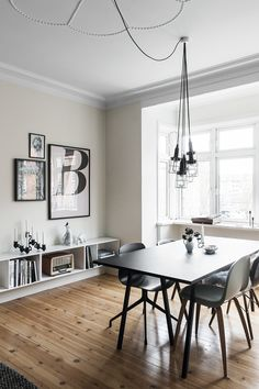 Nordic and bright dining space with dining table from Hay and dining chairs from Hay, Gubi, Eames and flea markets.