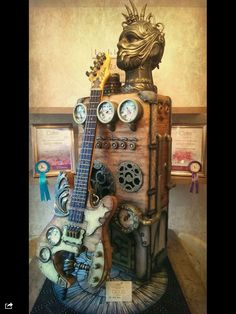 Steampunk freestanding guitar and amp cake.