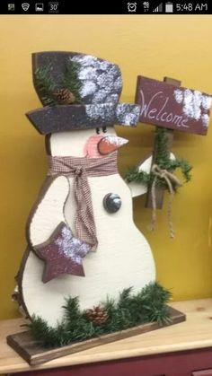 Cute tall rustic wood Christmas craft. Snowman with sign.