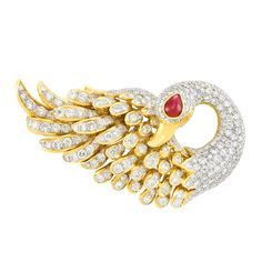 Two-Color Gold, Diamond and Cabochon Ruby Swan Pendant-Brooch 18 kt. yellow & white gold, round diamonds ap. 7.55 cts., one pear-shaped cabochon ruby, ap. 23.5 dwts.