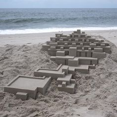 Geometric Doorways and Angular Turrets Form Sand Fortresses by Calvin Seibert | Colossal
