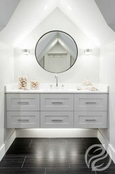 Cleanliness, relaxation and serenity all come to mind with any custom bathroom. Cabinetry isn't just for your kitchen; it lends practicality and design to your very own bathroom retreat. #GreenfieldCabinetry #CustomCabinetry #Bathroom #BathroomDesigner #Trend #Cabinets #BathroomDesignPicture #BathroomDesignPhoto #Image
