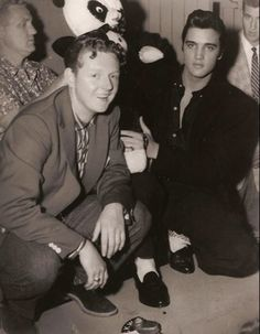 Elvis with Red Robinson, CKWX, at a press conference in Vancouver, B.C, Canada, 1957