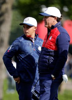 Rickie Fowler and Phil Mickelson of the United States look on during practice prior to the 2016 Ryder Cup at Hazeltine National Golf Club on September 27, 2016 in Chaska, Minnesota.