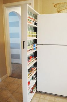 It's possible to set up shelving for cans and spices even in the narrowest spaces of the kitchen.
