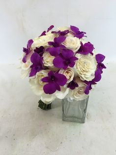 Ivory roses and purple dendrobium orchids