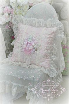 Our Cherub Square Pillow is so lush and feminine! Covered in exquisite hand-bead, embroidered and sequined lace. The addition of the sweet cherub with roses and pearl embellishments adds so much charm and elegance to this piece. Measure 18