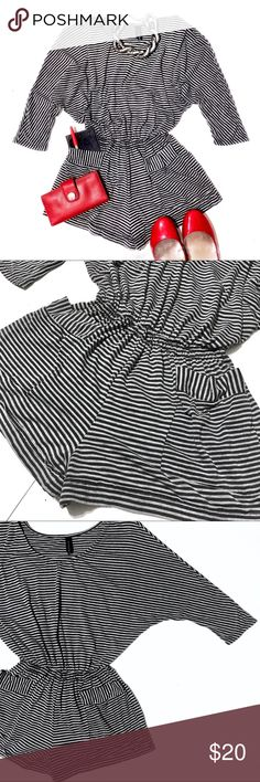 "Full Tilt Batwing Wide Scoop Neck Striped Romper By Full Tilt. Made in USA. Wide scoop neck, batwing three-quarter sleeve romper. Gray on gray stripes. Scoop neck can fall off the shoulder for added sex appeal. Elastic brings in the waist & allows flexibility in fit. Size S and can fit a M. EUC! Soft cotton feel is 49% polyester, 48% rayon, 3% spandex. 2 convenient pockets in the front add to it's style. It's silhouette gives the romper a cool, casual ""I just threw this on"" look and slinky…"
