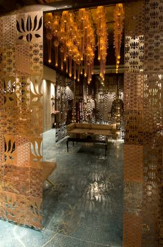 Lotus Design's interior for the Rohit Bal boutique in New Delhi, India. The screens and lighting are gorgeous.