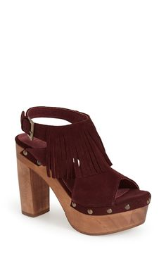 Obsessed with the wine color of this fringe platform slingback sandal.