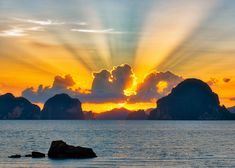 """I'm convinced there are no bad sunsets down here... every night has been an absolute stunner! That kind of light is called """"crepuscular"""" light, by the way, so there is a useless piece of knowledge for you. #80Stays #RCMemories #RCReserve #Krabi #Thailand #PhulayBayReserve"""