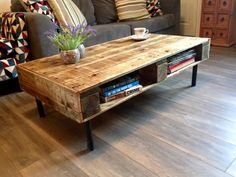 the front of the first coffee table we made, metal legs and shelves.
