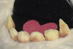 Grungy monster teeth built from makeup sponges