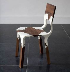 Injection molded plastic and wood chair.