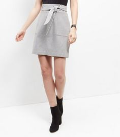 "Take this skirt from day to night when paired with heeled boots and a funnel neck top.- Tie waist- Double pocket sides- Casual fit that is true to size- Mini length- Riley is 5'10""/178cm and wears UK 10/EU 38/US 6"