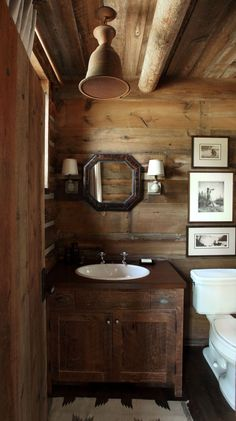 A family lodge set in a secluded location surrounded by forest service in Montana. This home is completely off the . Cabin Homes, Log Homes, Timber Homes, Wood Bathroom, Bathroom Lighting, Bathroom Ideas, Kitchen Lighting, Cabin Bathrooms, Small Bathrooms