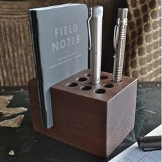 9 hole pen/pencil holder made from solid walnut that also stores up to three pocket notebooks. Approximate Dimensions: H - W - D Questions about hole sizing for your pen? Small Wood Projects, Diy Projects, Wooden Pen Holder, Wooden Desk Organizer, Painted Drawers, Homemade Tools, Pen Holders, Pencil Holder, Woodworking Projects Diy