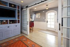 These sliding French doors shut out noise from the entertainment room, but still let plenty of light in.