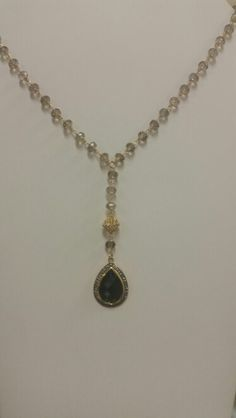 Beautiful AAA quality smoky quartz hand wrapped chain with eye catching onyx pendant