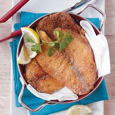 Flavor budget-friendly tilapia fillets with Cajun (or Creole) seasoning, dredge in flour and cornmeal, and pan fry for a quick-cooking weeknight meal. Pan Fried Tilapia, Pan Fried Pork Chops, Pan Fried Fish, Cajun Tilapia, Fish Fry, Parmesan Tilapia, Shrimp, Tilapia Recipes, Fish Recipes