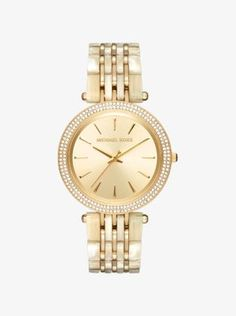A little glam, a little girl next door—our Darci watch delivers chic attitude every time. A pavé-embellished bezel and polished gold-tone dial lends eye-catching flair, while the two-tone bracelet strap renders this timepiece exceptionally elegant.