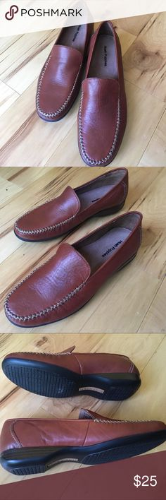Women's mocassin Nice pair of shoes. Never worn before; very comfortable for everyday use. The color is red brownish. Hush Puppies Shoes Flats & Loafers