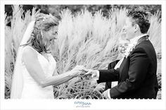 Brides exchanging rings while laughing in the cleveland botanical gardens