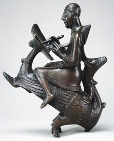 Monk-Scribe Astride a Wyvern, 12c. The Metropolitan Museum of Art