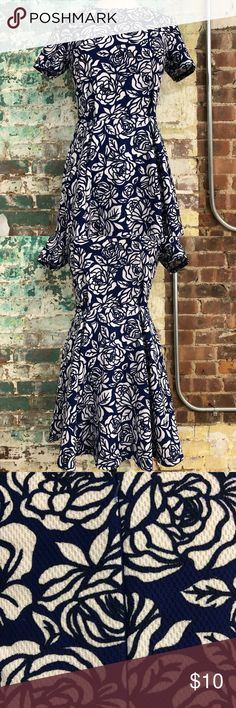 Floral dress This is a blue and white floral peplum dress. Worn once. Dresses Midi