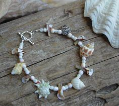 """This shell laden beach bracelet just says """"naturally done"""" to me. Will look great with a light summer wardrobe. Artist: Kristi Jones Kristi Jones Designs"""