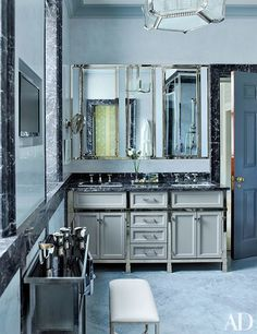 Master Bathroom in blue and grey tones while incorporating black accents | archdigest.com